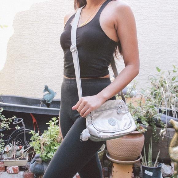 1f4cd91d6674 Kipling Handbags - Kipling Sabian Metallic Silver Mini Crossbody Bag
